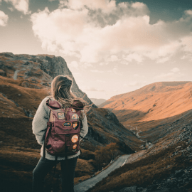Hiker facing a Lake District valley